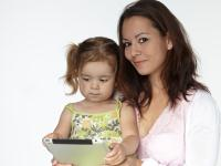 motheranddaughterwithtouchpad_34009348.jpg